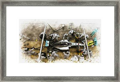 Lewis Hamilton Of Britain Service The Car At Pit Stop Framed Print