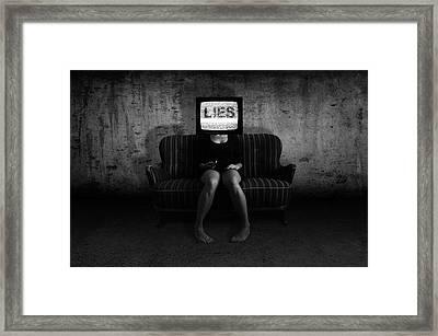 Lies Framed Print