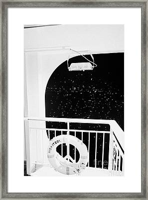 lifebelt on board the hurtigruten ship ms midnatsol at night in winter in Tromso troms Norway europe Framed Print by Joe Fox