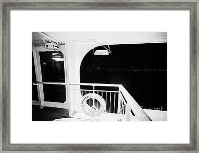 lifebelt on board the hurtigruten ship ms midnatsol at night in winter in Tromso troms Norway Framed Print by Joe Fox