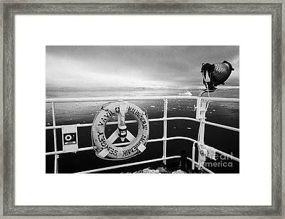 lifebelt on expedition ship covered in snow moored in Fournier Bay on Anvers Island Antarctica Framed Print by Joe Fox