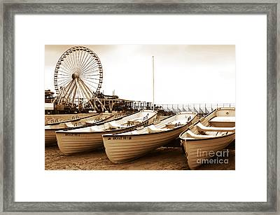 Lifeguard Boats Framed Print by John Rizzuto