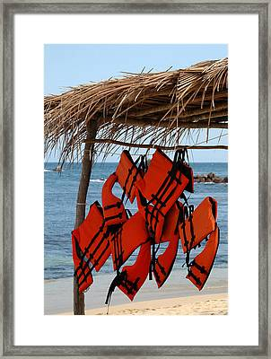 Lifejackets Hanging At The Ready On A Beach In The Huatulco Area Framed Print by Rob Huntley
