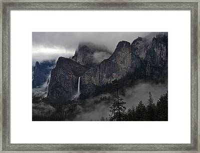 Lifting Fog And Clouds At Bridalveil Fall Framed Print by Steven Barrows