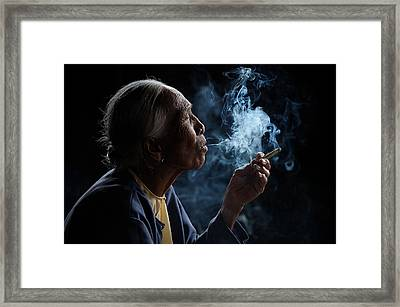 Light & Smoke Framed Print by Vichaya