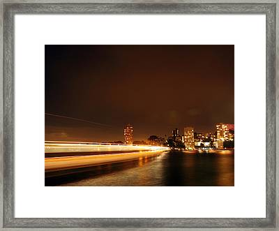 Light Across The Bay Framed Print by Justin Woodhouse