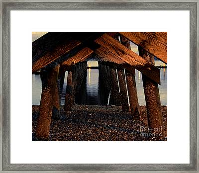 Light At The End Of The Pier Framed Print by Deanna Proffitt