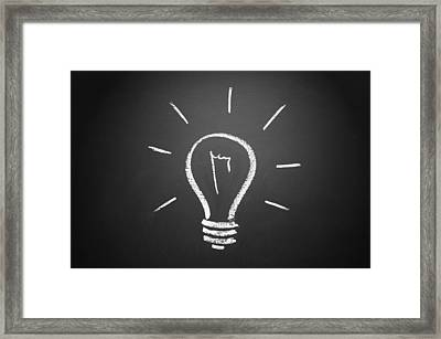 Light Bulb On A Chalkboard Framed Print