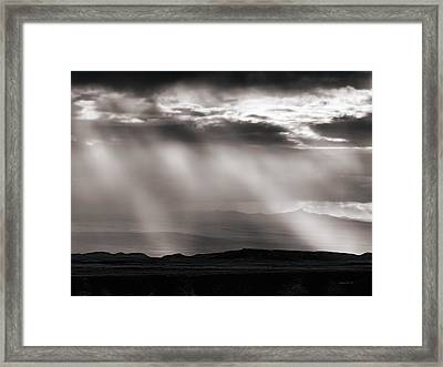 Light Rays And Rain Framed Print by Leland D Howard