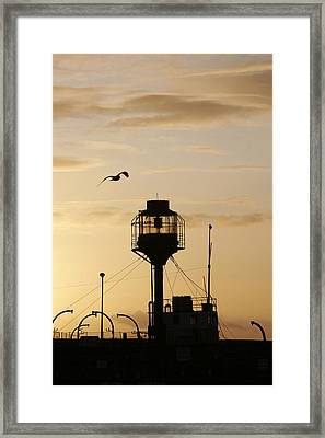 Light Ship Silhouette At Sunset Framed Print