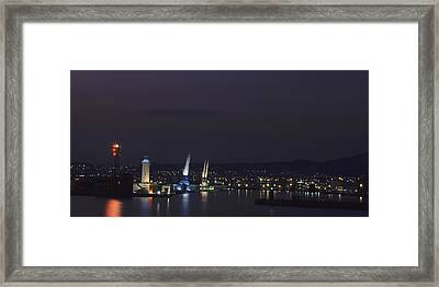 Lighthouse And Cranes At Night Framed Print by Panoramic Images