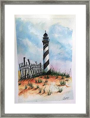 Lighthouse And Fence Framed Print
