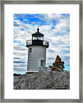 Lighthouse And The Cairn Framed Print