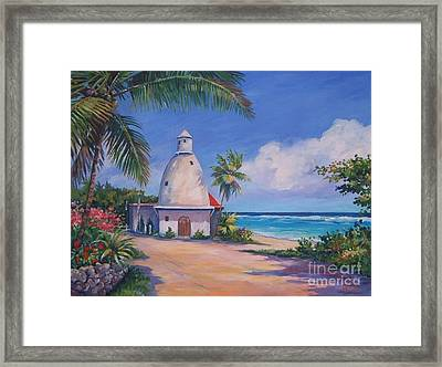 Lighthouse At Breakers Framed Print by John Clark