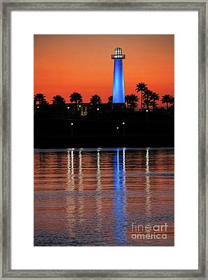 Lighthouse At Queensway Bay Framed Print