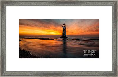 Lighthouse At Sunset Framed Print by Adrian Evans