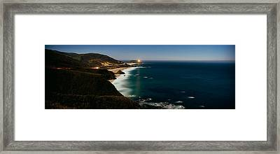 Lighthouse At The Coast, Moonlight Framed Print by Panoramic Images