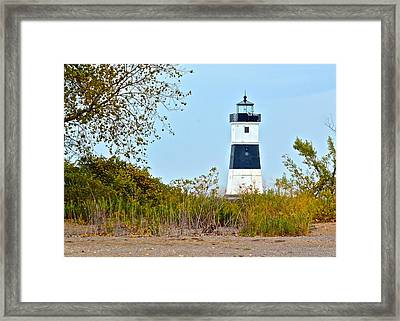 Lighthouse At The Dune Framed Print by Frozen in Time Fine Art Photography