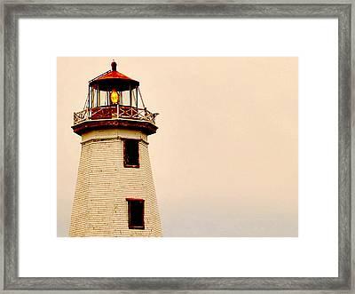 Lighthouse Beam Framed Print by Steve Archbold