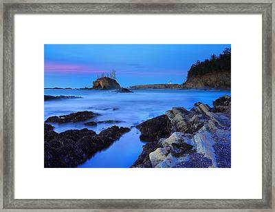 Lighthouse From Sunset Bay Framed Print