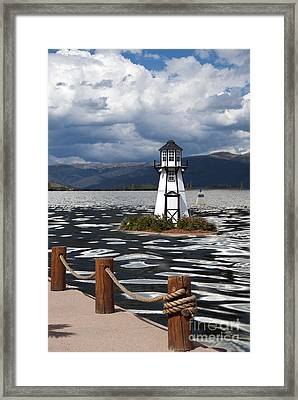 Lighthouse In Lake Dillon Framed Print by Juli Scalzi