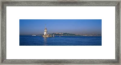 Lighthouse In The Sea With Mosque Framed Print