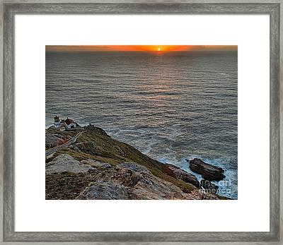 Lighthouse On A Cliff Framed Print