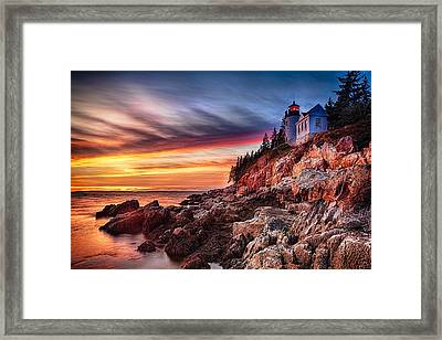 Lighthouse On A Cliff At Sunset Framed Print by George Oze