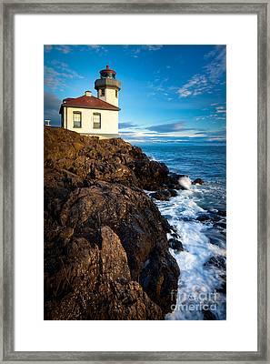Lighthouse On Bluff Framed Print