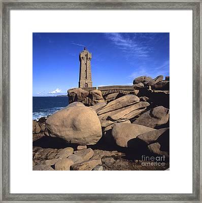 Lighthouse On Rocky Seashore. Brittany. France Framed Print by Bernard Jaubert