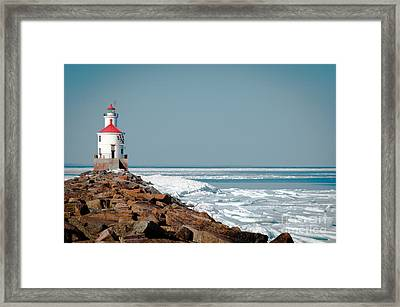 Lighthouse On Stone And Ice Framed Print
