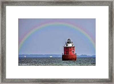 Lighthouse On The Bay Framed Print by Brian Wallace
