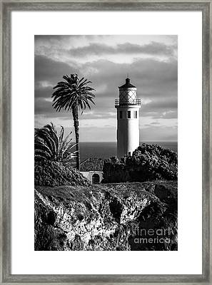 Framed Print featuring the photograph Lighthouse On The Bluff by Jerry Cowart