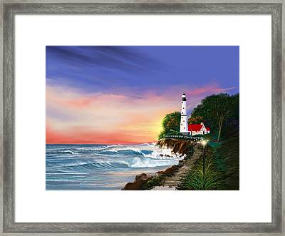 Lighthouse On The Cliff Framed Print by Anthony Fishburne