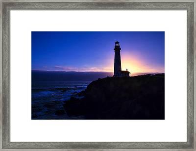 Lighthouse Setting Sun Framed Print by Garry Gay