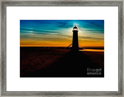 Lighthouse Silhouette Framed Print by Adrian Evans
