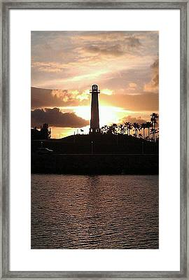 Framed Print featuring the photograph Lighthouse Sunset by John Glass