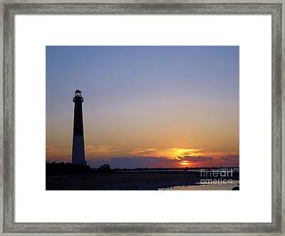 Lighthouse Sunset Framed Print by Art Dingo