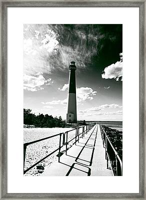Lighthouse Walk Framed Print by John Rizzuto