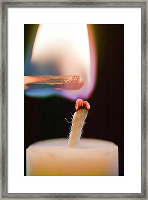 Lighting A Candle With A Match Framed Print by Ashley Cooper