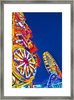 Lighting Up The Night Sky Framed Print by Olivier Le Queinec