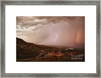 Lightning And A Rainbow Framed Print