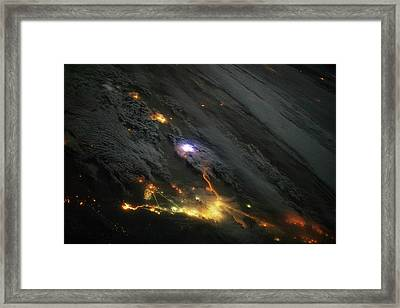 Lightning And City Lights Framed Print by Nasa
