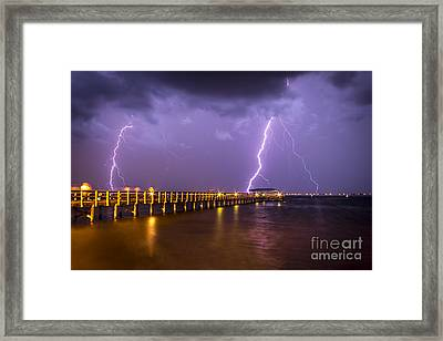 Lightning At The Pier Framed Print by Marvin Spates