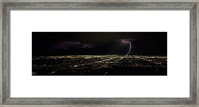 Lightning In The Sky Over A City Framed Print