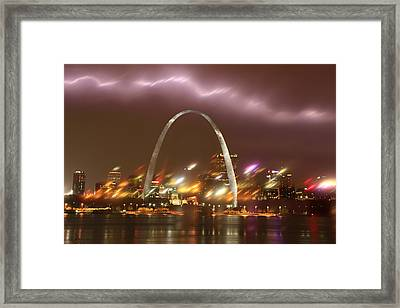 Lightning Over The Arch Framed Print by Garry McMichael