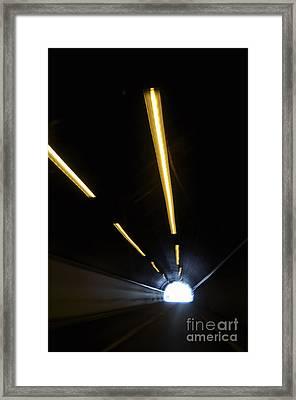 Lights Inside A Highway Tunnel Framed Print by Sami Sarkis