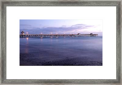 Lights On The Pier Framed Print by Richard Cheski