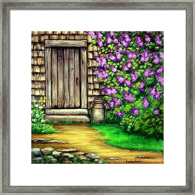 Lilacs By The Barn Framed Print