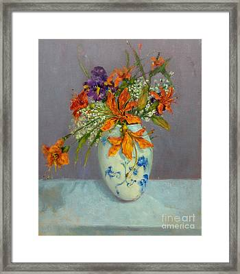 Lilies In Delft Framed Print